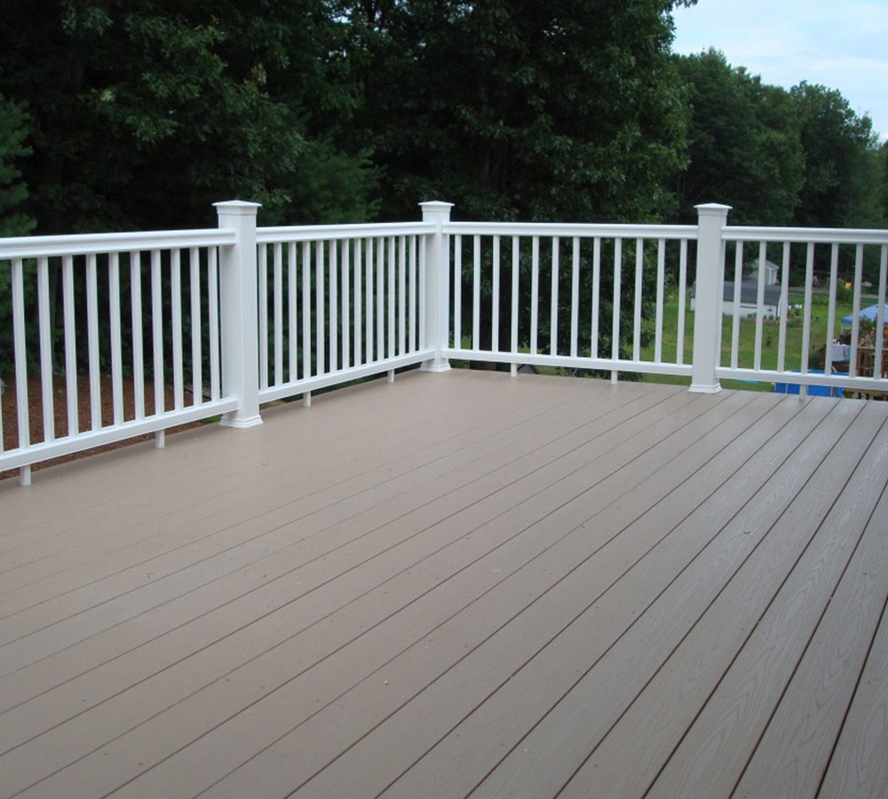 https://www.solidstateconstruction.com/wp-content/uploads/2020/04/Composite-AZEK-Deck-Solid-State-Construction-MetroWest.jpg
