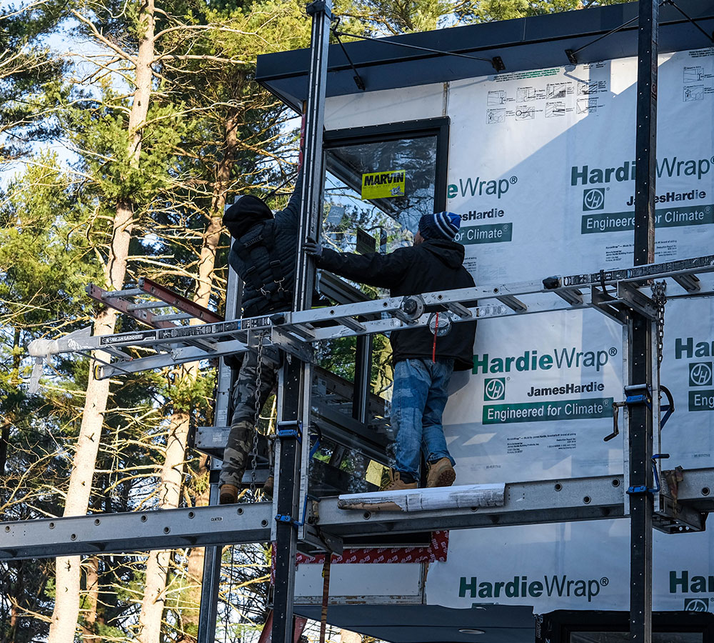 https://www.solidstateconstruction.com/wp-content/uploads/2020/04/Solid-State-Construction-James-Hardie-Fiber-Cement-Siding-Installers-Siding-Installation-Central-MA.jpg