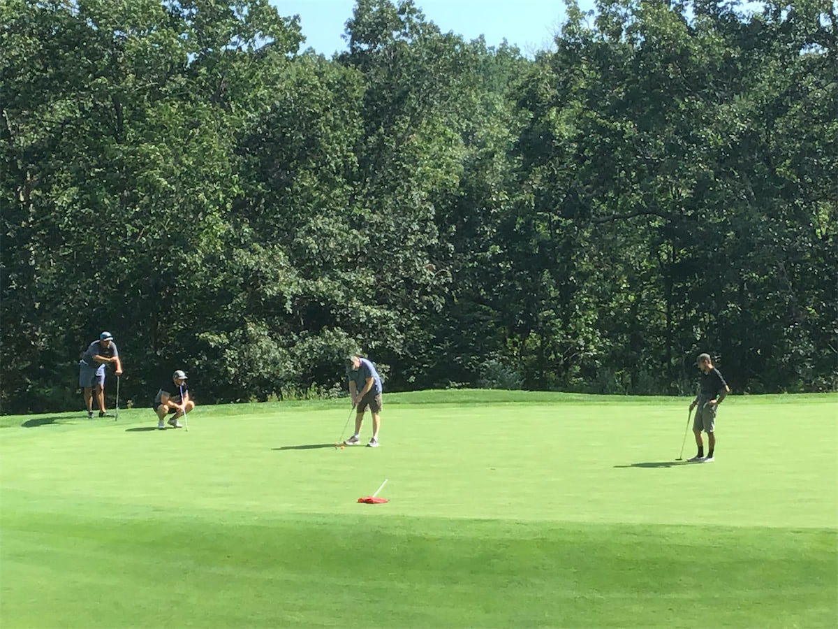 Image of Solid State Community Golf Tournament in action