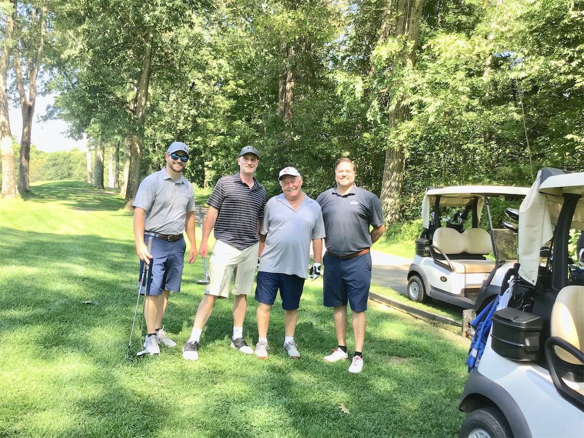 Solid State Community Golf Classic team on the green