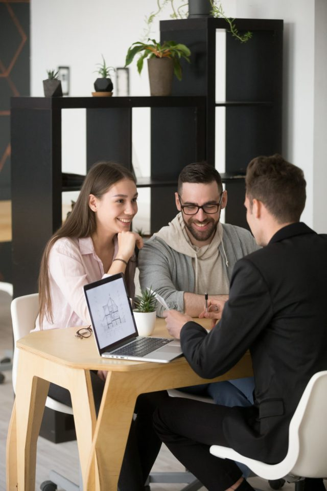 contractor sitting with clients earning a reputation