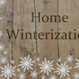 """home winterization"" written on a wooden background with snowflakes. A complete checklist by solid state construction."