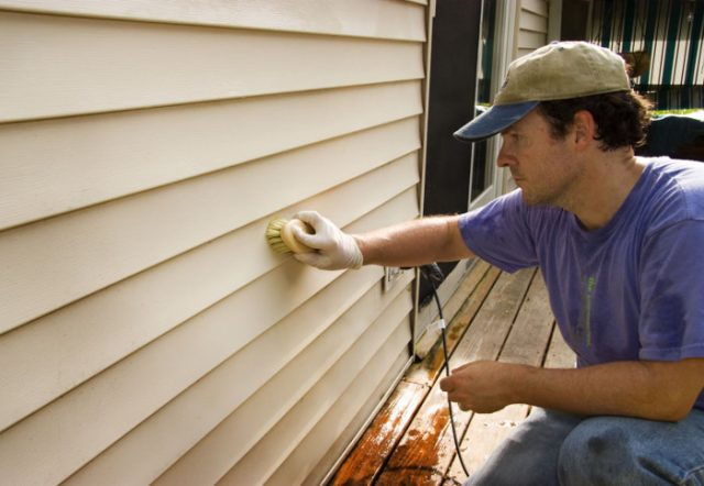 cleaning siding with a soft bristle brush