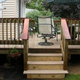 This is an image of a beautiful residential wood deck, custom built for the Central MA area by Solid State Construction.