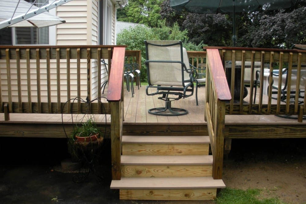 https://www.solidstateconstruction.com/wp-content/uploads/2021/05/how-to-maintain-a-wood-deck.jpg